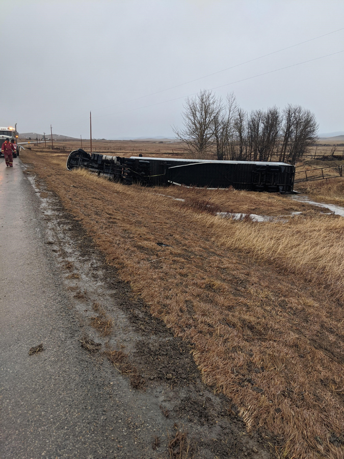 Big Rig Towing Wind Blown Roll Over